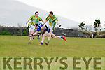 Renards Conor O'Leary falls foul of Lispole's dual attackers Gareth Noonan & Alan Devane.