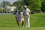 Damien McGrane and his caddy line up his putt on the 1st green during Round 2 of the BMW PGA Championship at  Wentworth, Surrey, England...Photo Golffile/Eoin Clarke.(Photo credit should read Eoin Clarke www.golffile.ie)....This Picture has been sent you under the condtions enclosed by:.Newsfile Ltd..The Studio,.Millmount Abbey,.Drogheda,.Co Meath..Ireland..Tel: +353(0)41-9871240.Fax: +353(0)41-9871260.GSM: +353(0)86-2500958.email: pictures@newsfile.ie.www.newsfile.ie.