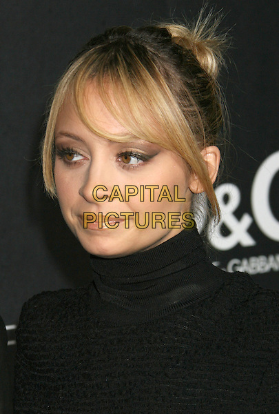 NICOLE RICHIE .Boutique Opening Benefiting The Art of Elysium held at the Dolce & Gabana Boutique on Roberston Blvd, Beverly Hills, California, USA..December 15th, 2008.headshot portrait black high collar turtleneck polo neck .CAP/ADM/MJ.©Michael Jade/AdMedia/Capital Pictures.
