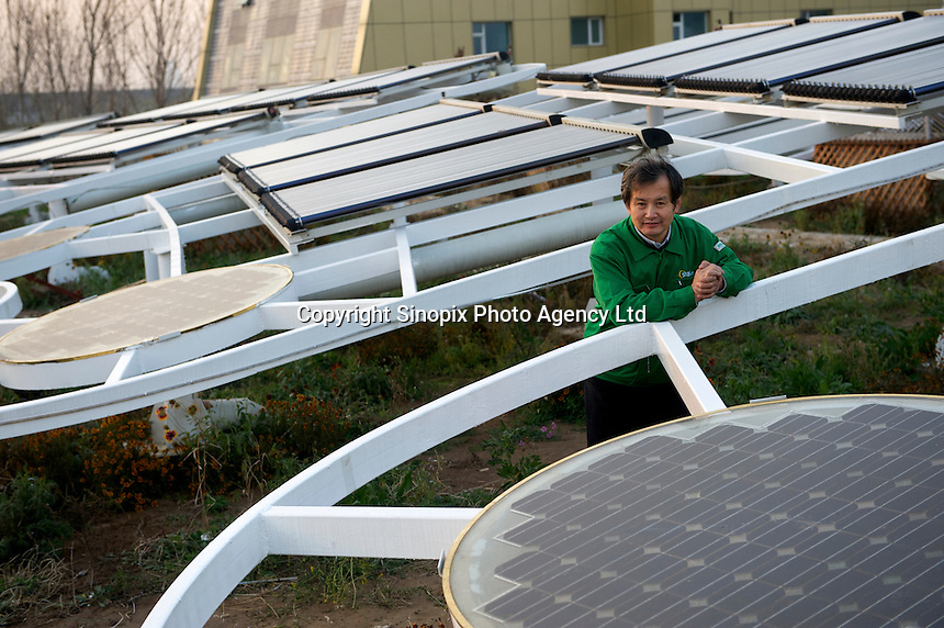 Huang Ming, chairman of Himin Solar Co., Ltd., poses in the ?Solar Valley? of Dezhou, Shandong Province, China.