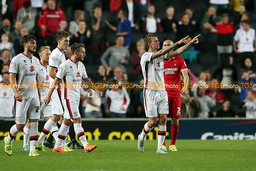 Mk Don's last minute winner goalscorer Carl BAker celebrates during MK Dons vs Leyton Orient, Capital One Cup 1st Round Football at stadium:mk, Milton Keynes, England on 11/08/2015