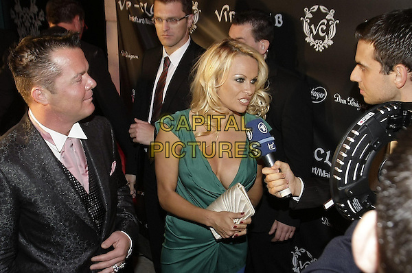 MARKUS  RINZ VON ANHALT & PAMELA ANDERSON .The 'Blonde is Beautiful' party, VIP Club, Frankfurt am Main, Germany..May 14th, 2009.half length green dress black suit jacket microphone cleavage.CAP/PPG/PRO.© Prosswitz/People Picture/Capital Pictures