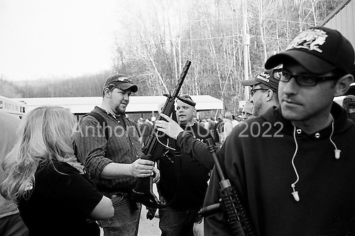 Machine Gun Shoot<br /> Knob Creek<br /> Westpoint, Kentucky<br /> USA<br /> April 4, 2009<br /> <br /> Nearly 16,000 people attend the Knob Creek Machine Gun Shoot &amp; Military Gun Show. It is the largest gathering of Civilian owned machine guns in the world. The gun show has over 700 tables with machine guns, military surplus, ammo, hard to find parts &amp; pieces and regular firearms and supplies.<br /> <br /> Certain automatic weapons, some say, are a better investment then Wall Street as the value rises so quickly due to stricter bans and new laws outlawing the import of such weapons. Young trades know their game and weapons.<br /> <br /> Firearms sales have surged in the six months since Obama's election as millions of Americans have gone on a buying spree that has stripped gun shops in some parts of the country almost bare of assault weapons and led to a national ammunition shortage.<br /> <br /> The FBI says that since November more than seven million people applied for criminal background checks in order to buy weapons, a figure excluding the many more buying at thousands of gun shows in states such as Virginia, without facing any checks.<br /> <br /> Gun-shop owners and the National Rifle Association say the surge is driven by worries that Obama is planning to ban many types of firearms and that the deepening economic crisis will fuel a crime wave, as witnessed by the string of mass shootings in the past few weeks.<br /> <br /> But control groups pressing for greater control on firearms accuse the NRA of funding a massive scare campaign to portray Obama as a gun owner's worst nightmare and to argue that tighter restrictions on weapons ownership are a threat to broader liberties and a step toward tyranny.