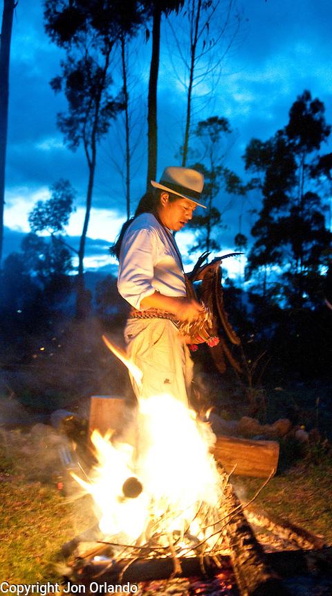 Oscar Santillan performs an early morning cermony on his land near Otavalo, Ecuador.