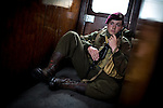 © Joel Goodman - 07973 332324 . 24/05/2014 . Heywood Station , Railway Street , Heywood, UK . Matthew Marcantonatos (16 from Rochdale ) (correct) , sits on the train wearing Canadian airborne division uniform . 1940s weekend on the East Lancs Railway , with visitors dressed up and partaking in 40s-themed events . Photo credit : Joel Goodman