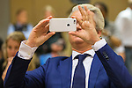 Dutch far-right Party for Freedom (PVV) leader Geert Wilders takes a picture of the photographers prior to his trial in the courtroom in the courthouse in Schiphol, the Netherlands March 18, 2016. <br /> REUTERS/Michael Kooren