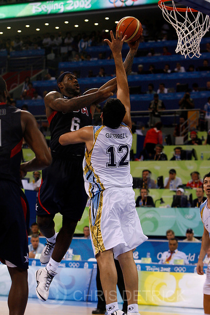 USA's Lebron James shoots over Argentina's Leonardo Martin Gutierrez, #12, during the semifinals game at the Olympic Basketball Gymnasium in Beijing, Friday, August 22, 2008.  USA won the game against Argentina 101-81...Chris Detrick/The Salt Lake Tribune.