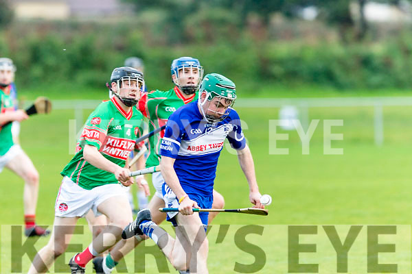 Balancing act<br /> -------------------<br /> Eric Leen, St Brendans, Gets chased by Darragh Kennelly&amp;Eamon Shanahan, Crotta , when the sides clashed in the U21 county hurling championship semi final at the John Mitchells GAA ground, Tralee last Saturday evening