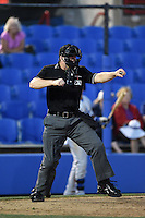 Home plate umpire Ryan Benson makes a call during a game between the Daytona Cubs and Dunedin Blue Jays on April 16, 2014 at Florida Auto Exchange Stadium in Dunedin, Florida.  Dunedin defeated Daytona 5-1.  (Mike Janes/Four Seam Images)