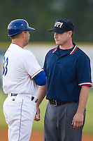 Burlington Royals manager Tony Tijerina (33) discusses a close call at first base with umpire Michael Cafaro at Burlington Athletic Park in Burlington, NC, Wednesday, August 13, 2008. (Photo by Brian Westerholt / Four Seam Images)