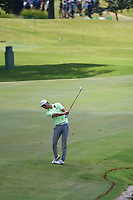 HaoTong Li (CHN) hits his approach shot on 9 during round 4 of the WGC FedEx St. Jude Invitational, TPC Southwind, Memphis, Tennessee, USA. 7/28/2019.<br /> Picture Ken Murray / Golffile.ie<br /> <br /> All photo usage must carry mandatory copyright credit (© Golffile | Ken Murray)