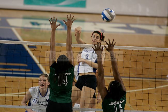 UK's Sarah Mendoza attempts the kill against Michigan State at Memorial Coliseum on Friday, Dec. 4, 2009. Mendoza finished the night with 13 kills to help the Cats defeat the Spartans in the first round of NCAA tournament play. Photo by Scott Hannigan | Staff