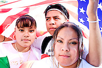 Yovan, foreground, with his brother Luis and sisters Jessica (right) and Yasmine at Union Square for the main rally for protesters of United States immigration policy in New York City on May 1, 2006, which was followed by an en masse march down Broadway towards City Hall.