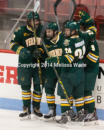 Brady Shaw (UVM - 22), Jonathan Turk (UVM - 8), Brady Shaw (UVM - 22), Kyle Reynolds (UVM - 9) - The visiting University of Vermont Catamounts defeated the Northeastern University Huskies 6-2 on Saturday, October 11, 2014, at Matthews Arena in Boston, Massachusetts.
