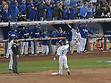 Norichika Aoki (Royals),<br /> OCTOBER 28, 2014 - MLB :<br /> Norichika Aoki of the Kansas City Royals raises his fist to teammates in the dugout at first base after hitting an RBI single in the bottom of the second inning during Game 6 of the 2014 Major League Baseball World Series against the San Francisco Giants at Kauffman Stadium in Kansas City, Missouri, United States. (Photo by AFLO)