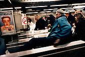 A fare-dodger leaps across a ticket gate in Paris' Republique metro.Picture taken 2005 by Justin Jin