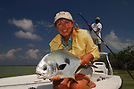 CATHY BECK WITH A PERMIT CAUGHT FLY FISHING