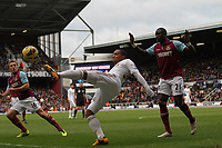 Barclays Premier League, West Ham United (red)V Swansea City Fc (white), Boelyn Ground, 02/02/13<br /> Pictured: Jonathan de Guzman gets in front of West Ham's Mohamed Diame<br /> Picture by: Ben Wyeth / Athena Picture Agency<br /> info@athena-pictures.com
