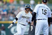 Paulo Orlando (16) of the Charlotte Knights rounds third base after hitting a home run against the Rochester Red Wings at BB&T BallPark on May 14, 2019 in Charlotte, North Carolina. The Knights defeated the Red Wings 13-7. (Brian Westerholt/Four Seam Images)