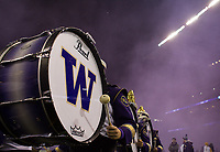 The Husky Band performs in a purple haze.