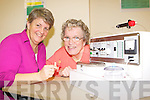 Hearing and Communication therapist Sally Harvest (left) gives Pauline Fleming Killarney a demonstration on the new Aura Care hearing aid cleaning machine on Wednesday which has been funded by Killarney Parish