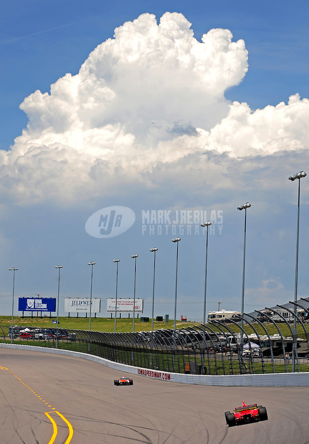 Jun. 20, 2008; Newton, IA, USA; IRL drivers race down the back stretch during practice for the Iowa Corn Indy 250 at the Iowa Speedway. Mandatory Credit: Mark J. Rebilas-