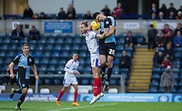 Luke O'Nien of Wycombe Wanderers & Adam McGurk of Portsmouth go up for the ball during the Sky Bet League 2 match between Wycombe Wanderers and Portsmouth at Adams Park, High Wycombe, England on 28 November 2015. Photo by Andy Rowland.