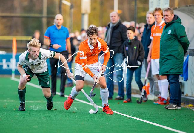 BLOEMENDAAL - Caspar van Dijk (Bldaal) met Jochem Bakker (Rdam)  tijdens  hoofdklasse competitiewedstrijd  heren , Bloemendaal-Rotterdam (1-1) .COPYRIGHT KOEN SUYK