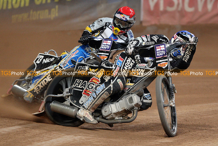 The Final: Chris Holder (blue) and Jaroslaw Hampel (red) - British Speedway Grand Prix at the Millennium Stadium, Cardiff - 10/07/10 - MANDATORY CREDIT: Rob Newell/TGSPHOTO - Self billing applies where appropriate - 0845 094 6026 - contact@tgsphoto.co.uk - NO UNPAID USE.