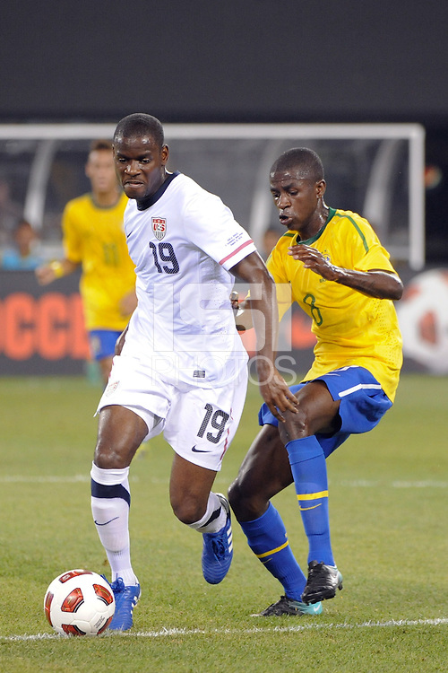 Maurice Edu (19) of the United States is marked by Ramires (8) of Brazil. The men's national team of Brazil (BRA) defeated the United States (USA) 2-0 during an international friendly at the New Meadowlands Stadium in East Rutherford, NJ, on August 10, 2010.