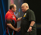 20.12.2014.  London, England.  William Hill World Darts Championship.  Andy Smith (28) [ENG] congratulates Ronny Huybrechts [BEL] after the match. Huybrechts won the match 3-0.