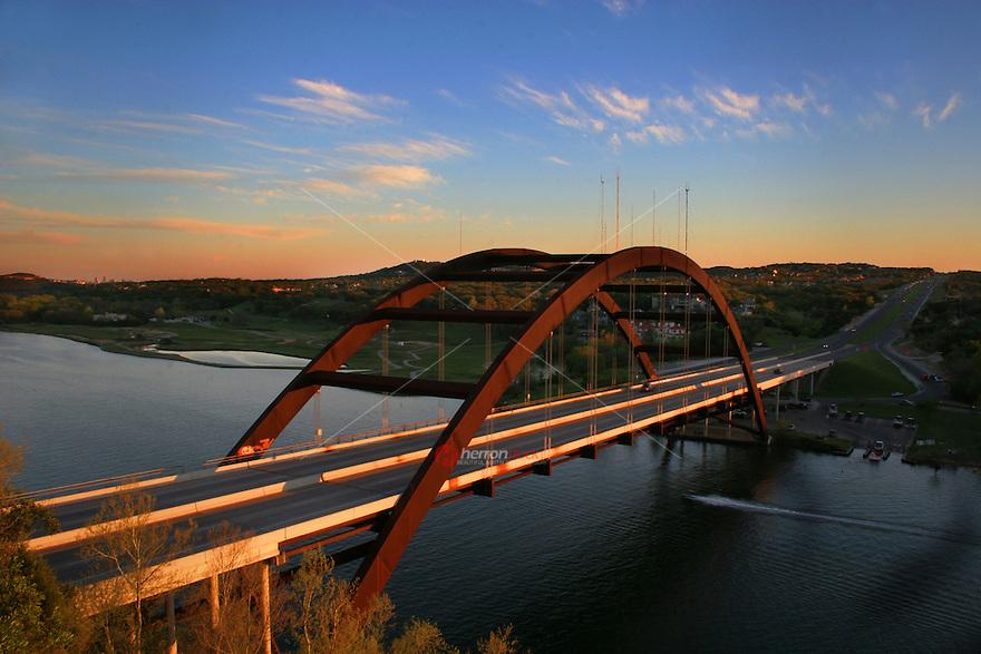 Beautiful afternoon Sunset at the 360 Bridge (Pennybacker Bridge) surrounding hills and lake austin, Texas, USA