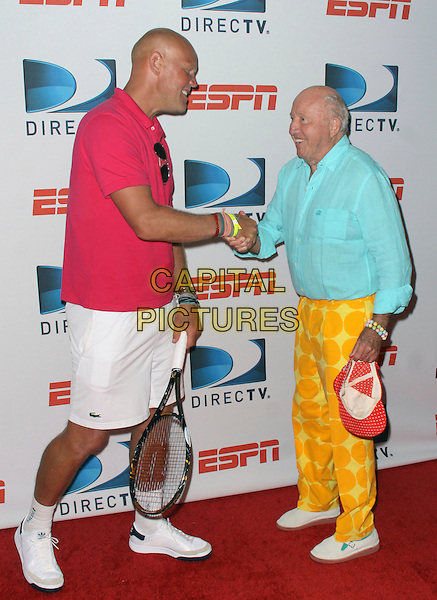MURPHY JENSEN & BUD COLLINS .DIRECTTV and ESPN brings the US Open to Bryant Park with the DIRECTTV ESPN US Open Experience, New York, NY, USA, 26th August 2009..full length red top t-shirt racquet white shorts trainers shaking hands yellow trousers green shirt  polka dot print  tennis.CAP/ADM/PZ.©Paul Zimmerman/Admedia/Capital Pictures