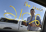 Chad Gerber with a hardy laugh after writing class of 2016 on the window of his car, prior to the Ellington High School graduation ceremony, June 10, 2016, in Ellington. (Jim Michaud / Journal Inquirer)