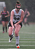 Micaela FitzPatrick #23 of North Shore chases after a loose ball during a rain-filled Nassau County League 3 varsity field hockey game at against Friends Academy at  North Shore High School in Glen Head on Thursday, Oct. 11, 2018. She scored two goals in North Shore's 3-1 win. (Note to editor: The 'P' in the subject's last name is capitalized.)