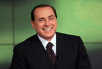 Il leader del Popolo della Liberta' Silvio Berlusconi parla durante la trasmissione Omnibus negli studi di La7 a Roma, 9 aprile 2008..Leader of the People of Freedom Silvio Berlusconi smiles during the talk show 'Omnibus', broadcasted by LA7 television in Rome, 9 april 2008..UPDATE IMAGES PRESS/Riccardo De Luca