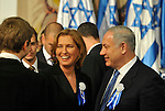 Israel's Foreign Minister Tzipi Livni, center, and nominated Prime Minister Benjamin Netanyahu, right, during the opening session of the Knesset, Israel's 18th parliament in Jerusalem, Israel, on Tuesday, Feb. 24, 2009. Peres urged Israel's new parliament to make peace efforts with the Palestinians its top priority as the assembly held its inaugural session today. Photographer: Ahikam Seri