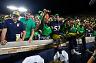 September 1, 2018; ; Players celebrate with students after Notre Dame defeated Michigan 17 to 24 in the opening season game. (Photo by Barbara Johnston/University of Notre Dame)