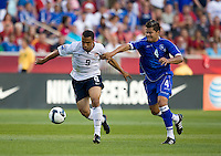 Charlie Davies of the USA battles for the ball with Mardoqueo Henriquez of El Salvador during a World Cup Qualifying match at Rio Tinto Stadium, in Sandy, Utah, Friday, September 5, 2009.  .The USA won 2-1..