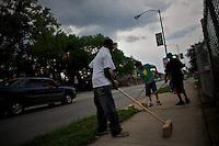 """young men, part of a rehabilitation program for former gang members promoted by """"Cease Fire"""", an American Non Profit Organization, clean the streets of Roseland, their neighborhood, in Chicago, Illinois, United States on Wednesday August 6 2008..Senator Barack Obama, the 2008 democratic party presidential candidate, begun his political career by being an organizer in these neighborhoods..Roseland and other South Side neighborhoods of Chicago are among the most violent and segregated in the country."""