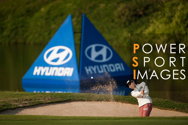 Soo-Hwa Jang of Korea hits her shot during the Hyundai China Ladies Open 2014 at World Cup Course in Mission Hills Shenzhen on December 13 2014, in Shenzhen, China. Photo by Xaume Olleros / Power Sport Images