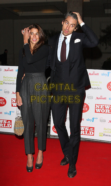 GUEST & GEORGE LAMB .At the Children's Champions Awards 2010, Grosvenor House Hotel, Park Lane, London, England, UK, .March 3rd 2010. .arrivals full length funny hands on heads touching hand head black suit red tie waistcoat navy blue grey gray high waisted trousers .CAP/ROS.©Steve Ross/Capital Pictures