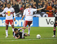 D.C. United midfielder Lewis Neal (24) gets fouled by New York Red Bulls defender Markus  Holgersson (5) The New York Red Bulls tied D.C. United 1-1 in the first leg of the Eastern Conference semifinals at RFK Stadium, Saturday November 3, 2012.