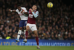 Tottenham's Serge Aurier and Burnley's Dwight McNeil challenge  during the Premier League match at the Tottenham Hotspur Stadium, London. Picture date: 7th December 2019. Picture credit should read: Paul Terry/Sportimage