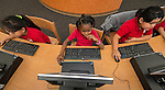 Students check out the new computer lab on Monday at the new Sherman Elementary School.