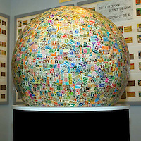The worlds largest stamp ball is solid and weighs 600 pounds was pasted together by the Boys Town stamp collecting club in the early 1950s located outside Omaha Nebraska