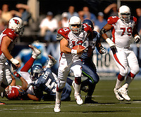 Sep 25, 2005; Seattle, WA, USA; Arizona Cardinals quarterback #13 Kurt Warner runs the ball against the Seattle Seahawks.in the first quarter at Qwest Field. Mandatory Credit: Photo By Mark J. Rebilas
