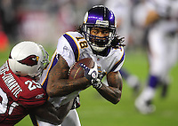 Dec 6, 2009; Glendale, AZ, USA; Minnesota Vikings wide receiver (18) Sidney Rice is tackled by Arizona Cardinals cornerback (29) Dominique Rodgers-Cromartie at University of Phoenix Stadium. The Cardinals defeated the Vikings 30-17. Mandatory Credit: Mark J. Rebilas-