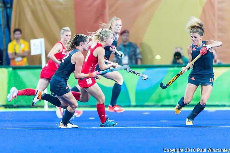 Sophie Bray #19 of Great Britain and Maria Verschoor #11 of Netherlands contest for the ball during Netherlands vs Great Britain in the gold medal final at the Rio 2016 Olympics at the Olympic Hockey Centre in Rio de Janeiro, Brazil.