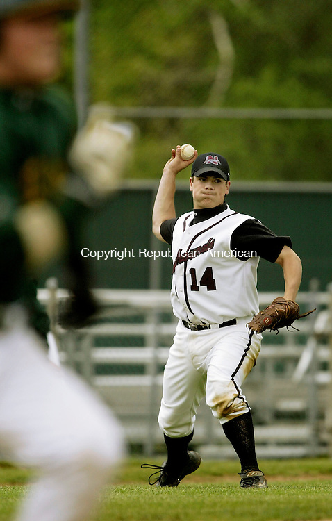 WATERBURY, CT - 26 MARCH 2005 -  052605JS04--Naugatuck's 14 throws out a Holy Cross runner during their NVL semi-final game Thursday at Municipal Stadium in Watebury --Naugatuck, Holy Cross, Municipal Stadium and Waterbury are CQ